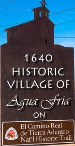 Welcome sign for The Traditional Village of Agua